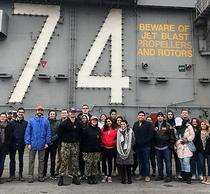 Schar School students and faculty tour the USS Stennis flight deck